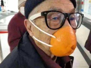 Maske kıtlığı çeken Çin'de, koranavirüse karşı akılalmaz yöntem!