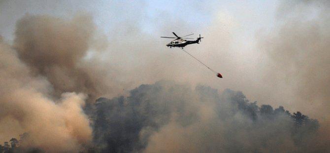 Kıbrıs'ın güneyinde çıkan yangına yardım için gelen helikopterlerden para istendi!
