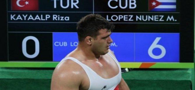 Irkçı söylemlerinden ceza alan milli güreşçi Rıza, Rio'da insanlık dersi aldı