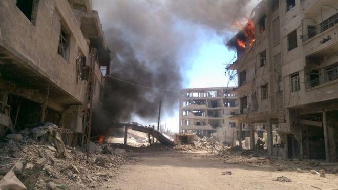 Suriye'de isyanın başladığı ilk kentlerden Deraya'da muhalifler çekiliyor