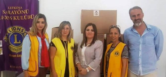 Lefkoşa Sarayönü Lions Kulübü ihtiyaçlılara iletilmek üzere Sosyal Hizmetler Dairesi'ne kıyafet bağışında bulundu