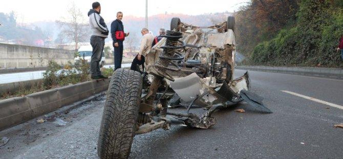 Takla atan otomobil metrelerce sürüklendi: Sürücü yara almadan kurtuldu