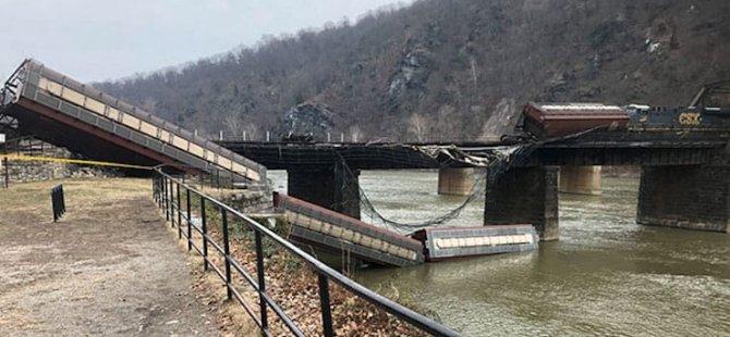 ABD'de yük treni raydan çıktı, vagonlar nehre yuvarlandı