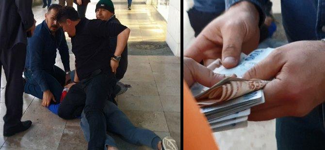 Polisten kaçarken karmaşa yaratmak için sokağa para saçtılar
