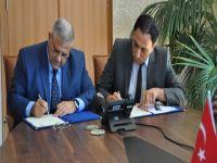 DAÜ, Kıbrıs Türk Gazeteciler Birliği ile protokol imzaladı
