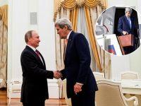Putin esprileriyle Kerry'yi şaşırttı