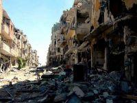 Esed güçleri karadan ve havadan saldırdı: 72 ölü