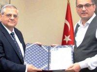 Erhürman DAÜ Rektörü Prof.Dr. Necdet Osam'ı kabul etti
