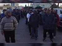 Pasaportlarına el konulan işçiler, hala şantiye içerisindeki barakalarda yaşıyor