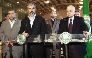 Senior Hamas leader Khaled Mashal (C) talks during a news conference with Arab League Secretary-General Nabil Al Araby (R), after their meeting at the Arab League headquarter